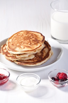 Breakfast with pancakes and strawberry jam