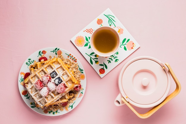 Breakfast with tea and waffles
