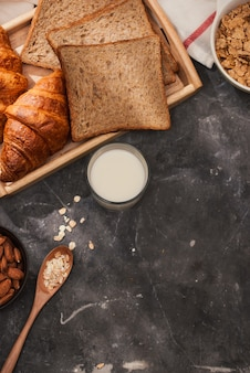 Breakfast with toast and croissant. milk in a glass bottle. good start to the day. good morning