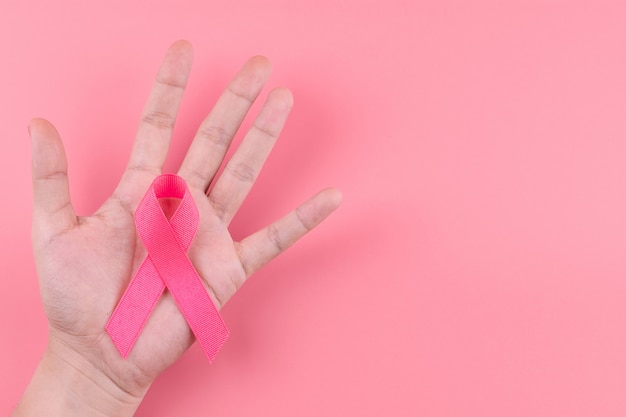 Breast cancer awareness month, pink ribbon supporting people living and illness. healthcare, international women day and world cancer day concept