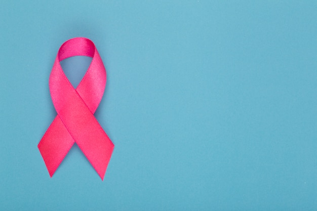Breast cancer awareness month. pink ribbon symbol of world breast cancer month in october and concept of healthcare. copy space