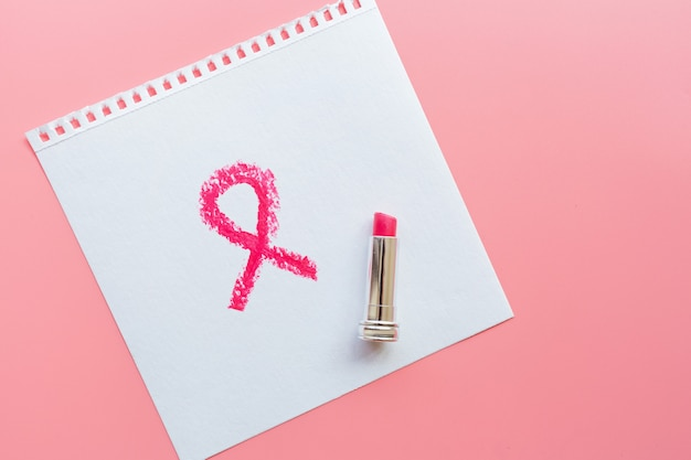 Breast cancer awareness symbol painted with pink lipstick.