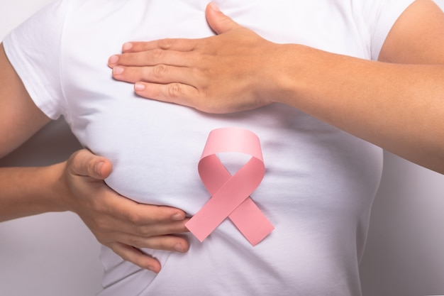 Breast cancer, pink ribbon symbol of fight against cancer.