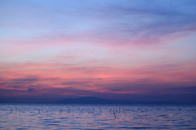 Breathtaking blue and purple color of the cloud layer on sunrise sky over the gulf of thailand
