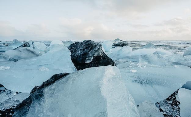 Breathtaking diamond beach on iceland in winter with large ice blocks ice cubes