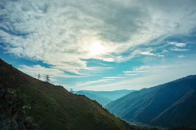 A breathtaking landscape of the valley among the hilly mountains.