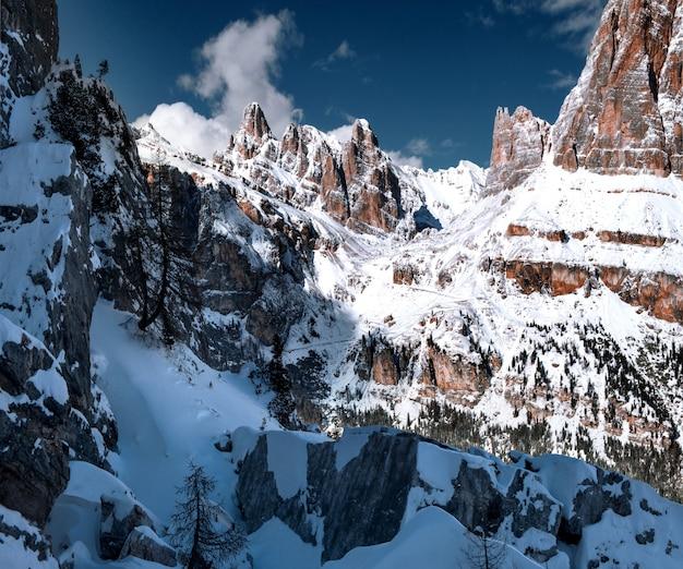Breathtaking scenery of the snowy rocks at dolomiten, italian alps in winter