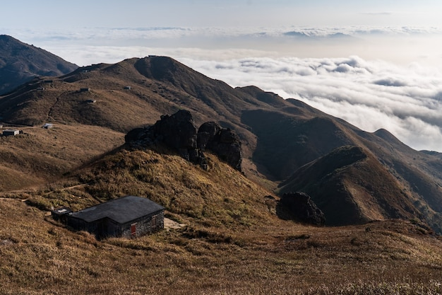 Breathtaking shot of the mountainous landscape above scenic clouds