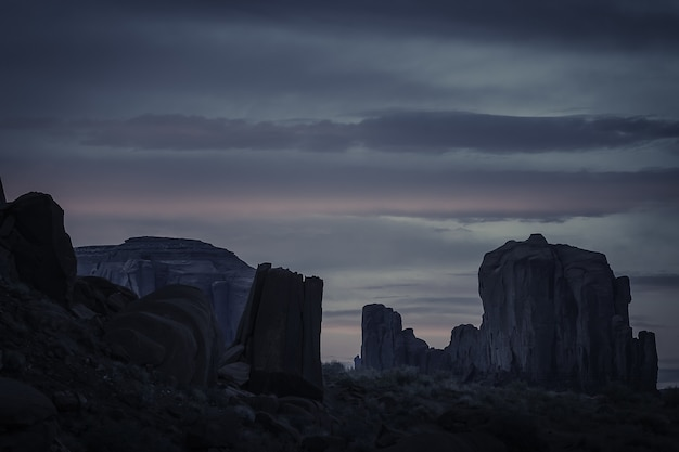 Breathtaking sunset in the cloudy sky over the canyon full of rock formations