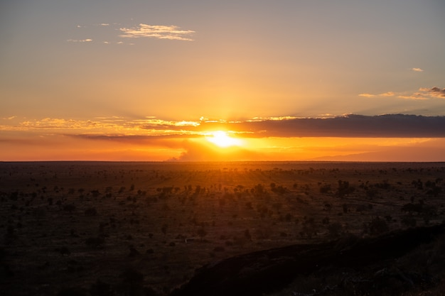 Breathtaking sunset in the colorful sky over a desert in tsavo west, kenya, kilimanjaro