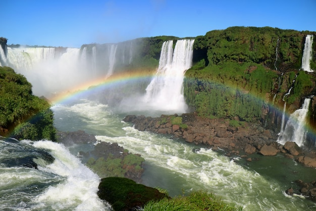 Breathtaking view of devil's throat area of iguazu falls from brazilian side with rainbow, brazil