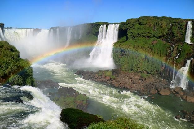 Breathtaking view of devil's throat area of iguazu falls from brazilian side with rainbow, brazil
