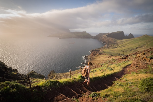 Breathtaking view of the hills and the lake under the fog captured in madeira island, portugal