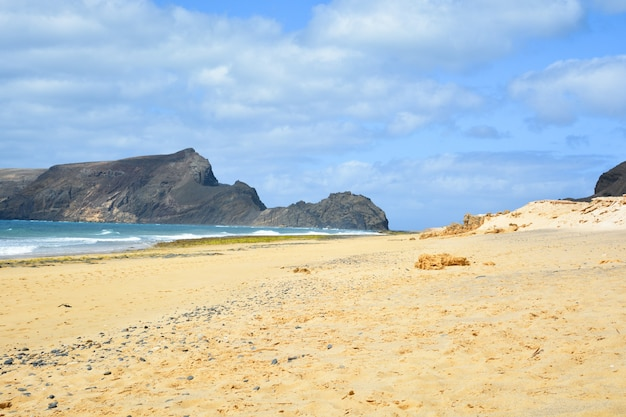 Breathtaking view of porto santo beach with a huge rock formation