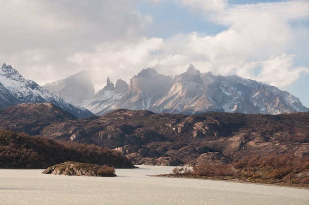 Breathtaking view of the snowy mountains under the cloudy sky in patagonia, chile