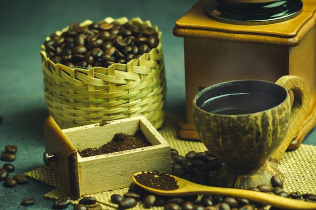Brew black coffee in coconut cup and morning lighting.