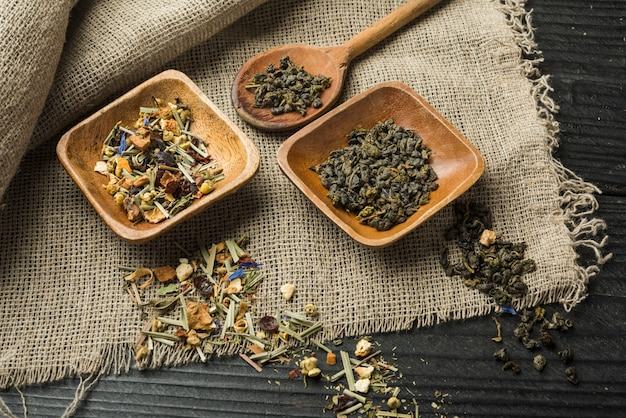 Brewed delicious herbal tea on wooden backdrop
