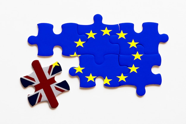 Brexit jigsaw puzzle concept on white background