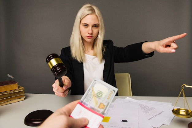 Bribing a young woman judge for a verdict in their favor -image