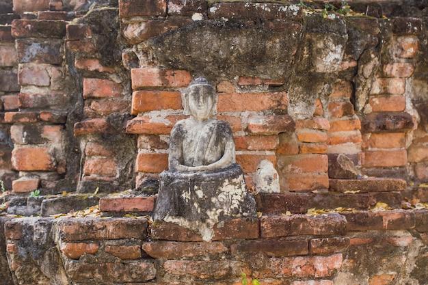Brick ancient buddha is broken.