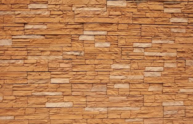 レンガの背景、壁、またはオレンジ色のブロックのテクスチャ