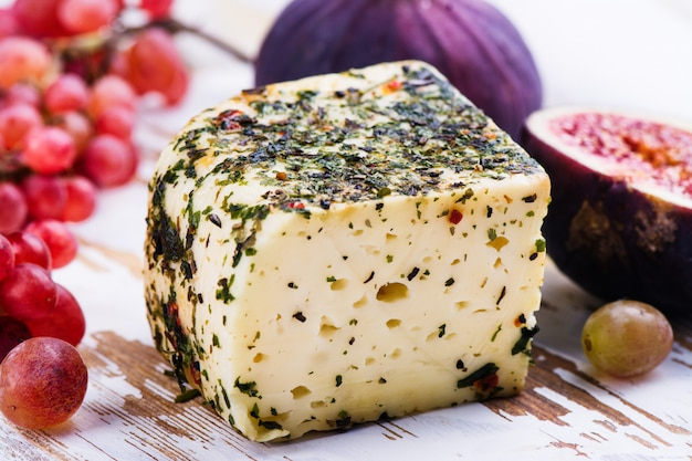 Brick of cheese with herbs and spices