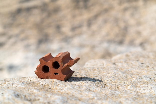 Brick chip on  big stone