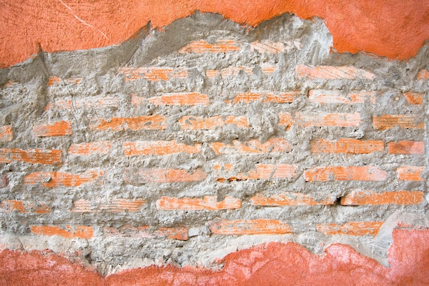 Brick hole in a orange concrete wall frame conceptual background texture
