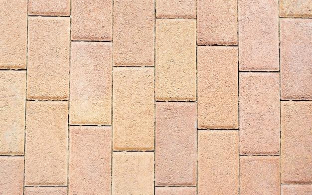 屋外の風景のためのレンガパターンの床タイルテクスチャ素材。パティオまたは歩道用の赤、アンティークの長方形のセラミッククリンカータイル、上面タイルのテクスチャ