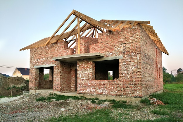 Brick residential house with wooden roof under construction