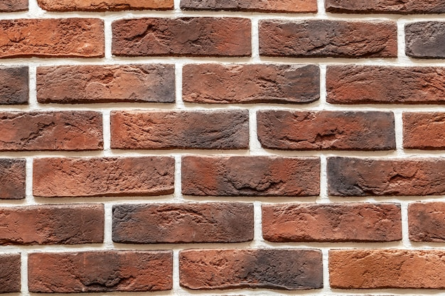 Brick stone wall made with blocks. pattern of slate wall texture and background