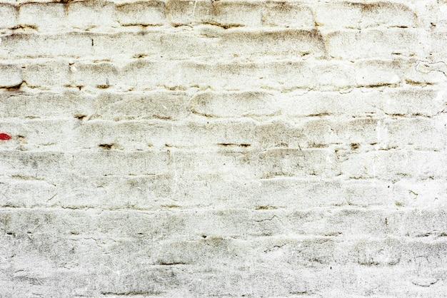 Текстура кирпича с царапинами и трещинами