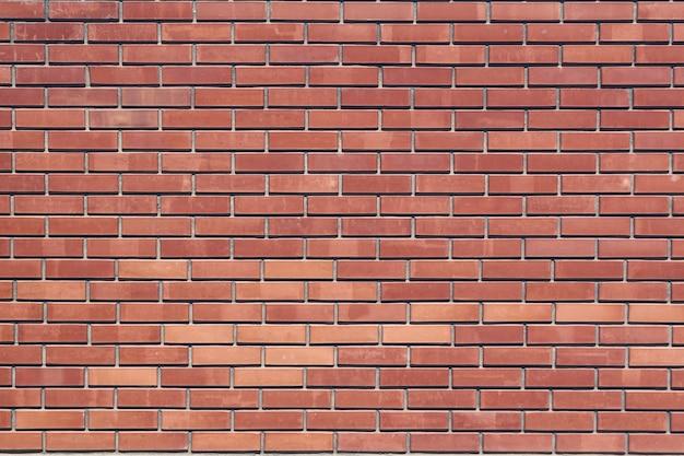 レンガの壁の背景、パターン、外側の赤レンガ。