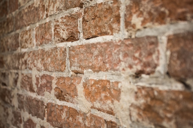 Brick wall background texture close-up with blurred details