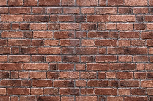 レンガの壁の背景のテクスチャ、レトロな産業の建物の建設の材料
