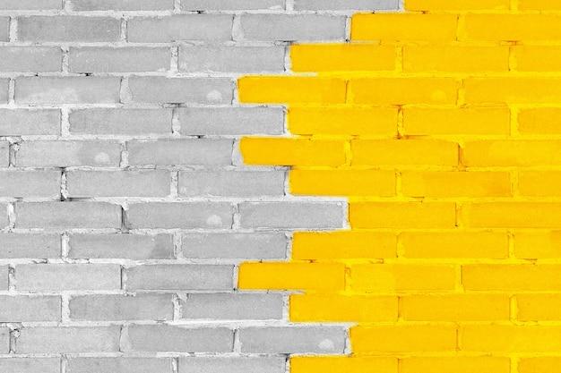 노란색 조명 및 궁극적인 회색의 벽돌 벽 2021년 익스트림 근접 촬영의 주요 최신 유행 색상. 3d 렌더링