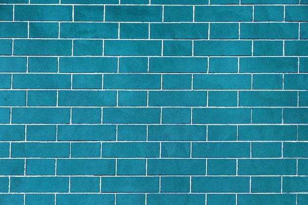 Кирпичная стена ярко-синего цвета, текстура каменных блоков, фон из кирпича