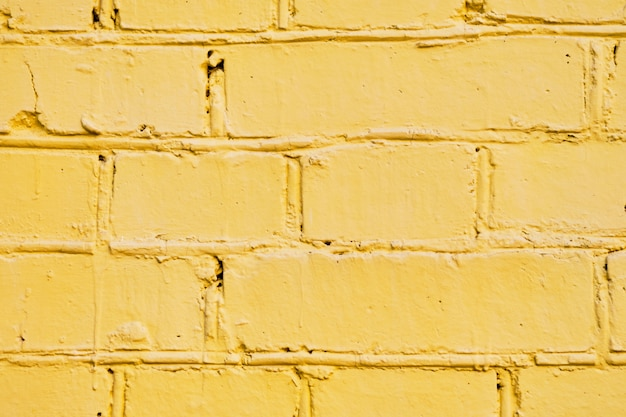 The brick wall is painted yellow. background.