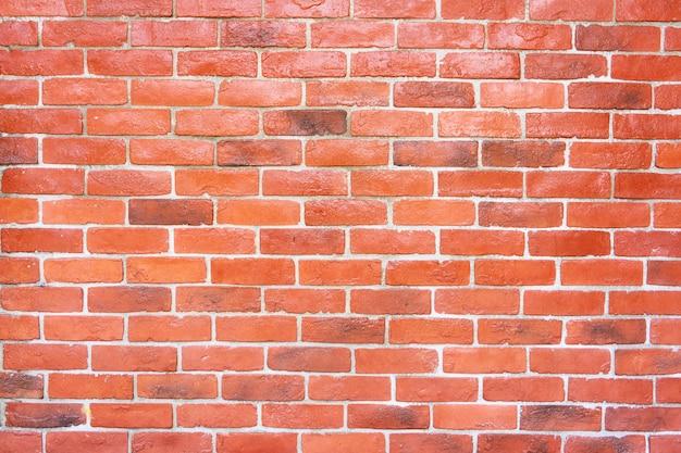 赤レンガで作られたレンガの壁。古典的な石積み。