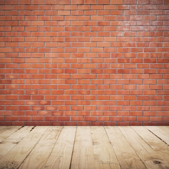 Brick wall room and wood floor background and texture with copy space.