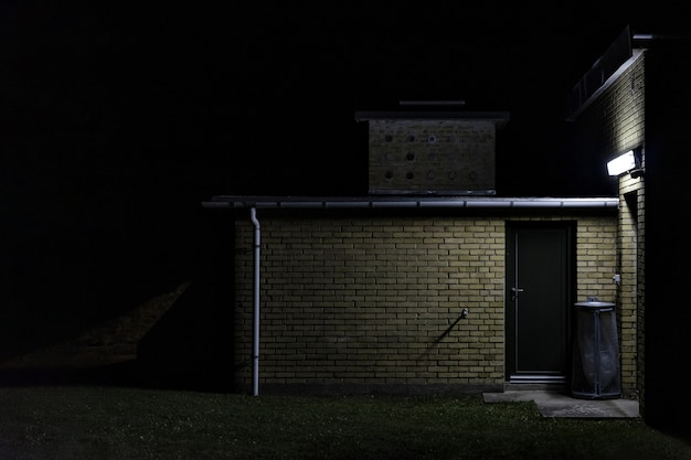 A brick wall storage room at night