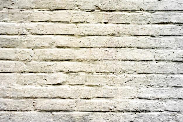 Предпосылка текстуры кирпичной стены. текстура кирпича с царапинами и трещинами