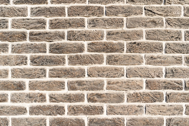 Brick wall. texture of gray creme brick with white filling