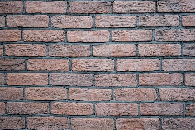 れんが壁。灰色の詰物と赤レンガのテクスチャ