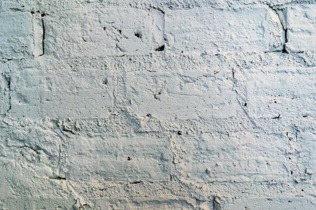 レンガの壁のテクスチャ。塗装済み完成品グランジホワイトストーンウォール表面の背景。