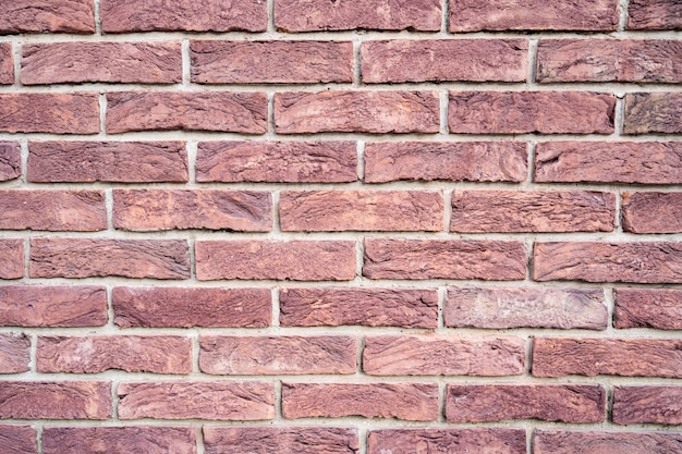 Brick wall. texture of red brick with white filling