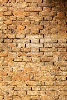 Brick wall with aged surface