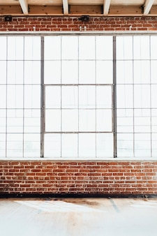 Brick wall with big glass window, interior background