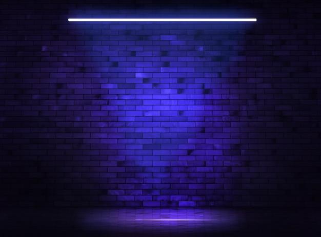반사와 네온 블루 라이트가 있는 벽돌 벽