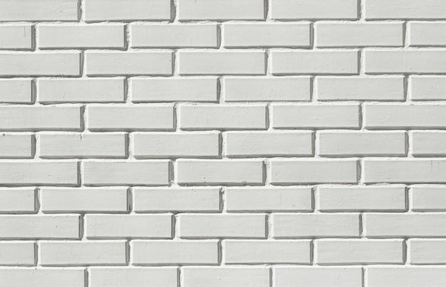 Кирпич белый фон стены. кирпичная кладка из белого камня. фото высокого качества